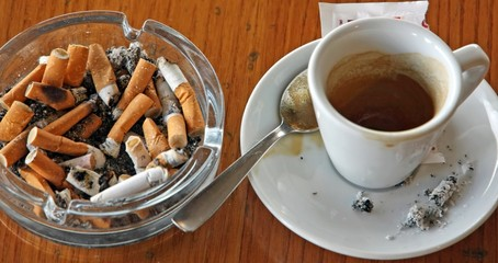 cup of coffee espresso and ashtray chock
