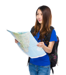 Asian traveler with map