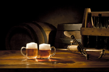 beer still life on the table with old keg of beer and tap