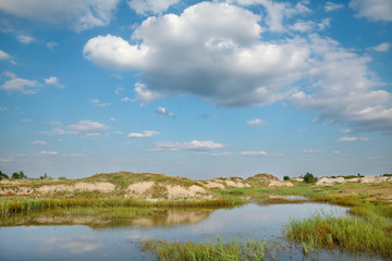 Marsh after sand excavation, landscape with beautiful sky
