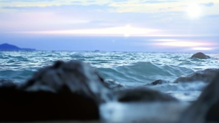 Waves hitting the sea shore on Samui island in sunset time