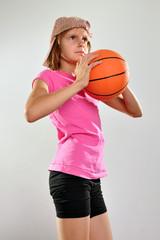 child playing basketball and throwing ball