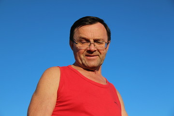 middle-aged man dressed in a red tank top