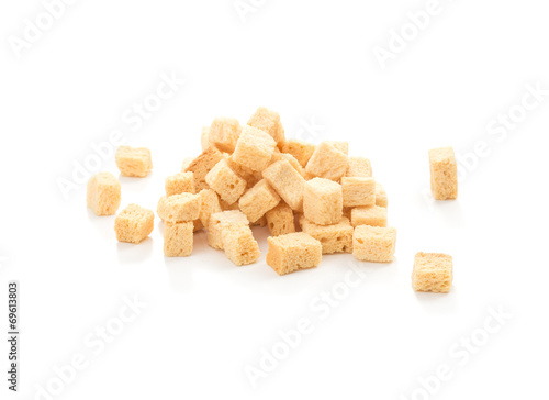 Fotobehang Brood cube croutons on a white background