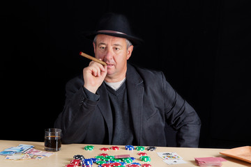 Man with a thoughtful look at poker