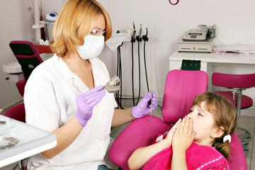 little girl is afraid of the dentist