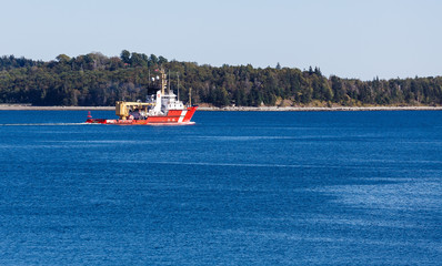 Orange Canadian Coast Guard Cutter on Blue Water