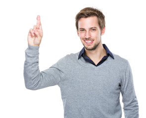 Caucasian man hand with finger crossed