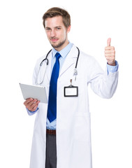 Medical doctor with tablet and thumb up