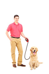 Happy young man and a dog on a leash