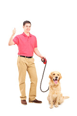 Young man with a dog giving thumb up
