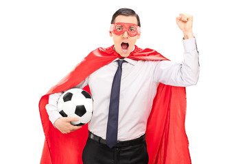 Superhero cheering and holding a football