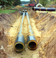 New water pipes mounting in a ground on a cloudy day