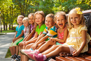 Kids on summer park bench