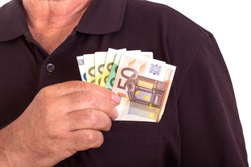 Man pushes money into his breast pocket