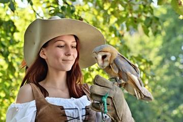 Falconer holding barn owl