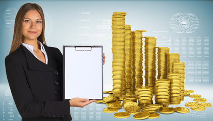 Business woman hold paper holder and pyramid from gold coins