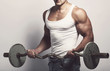 Fitness. Man with barbell