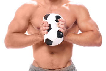 Strong man squeezing soccer ball