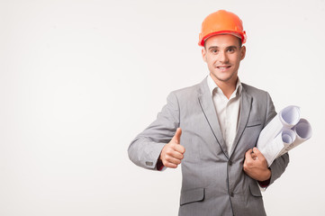 Young handsome architect engineer posing