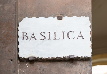 Old street plate  Basilica  in Aventine Hill in Rome, Italy