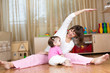 mother and kid doing gymnastic at home