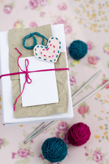 Old notebook for love notes, bright yarn balls and needles