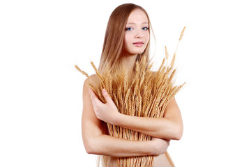 Beauty woman with ears of wheat
