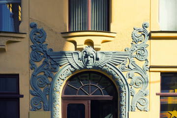 Bas-relief over the entrance to the art nouveau building in Riga