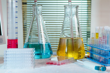 Table research laboratory with equipment chemical, test tubes, f