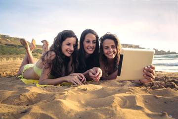 three young woman having fun on the beach