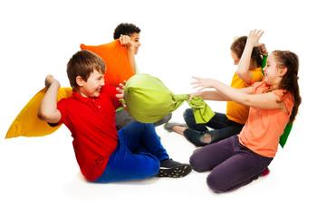 Four kids having pillow fight