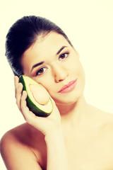 Beautiful woman holding avocado.