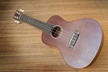 Vintage ukulele on wooden background