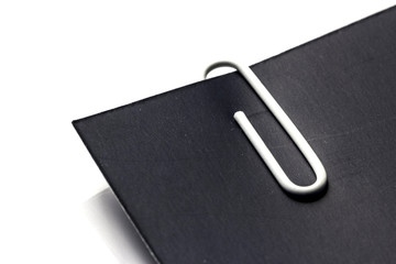 White Clip with Black Paper on White background