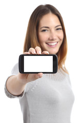 Happy woman showing a horizontal smart phone screen app