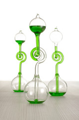 Chemistry glassware on the grey wooden table isolated