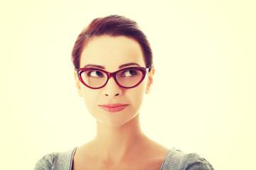 Portrait of beautiful woman in red eyeglasses.