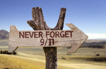 Never Forget 9/11 wooden sign on desert background