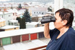 Senior woman with binoculars