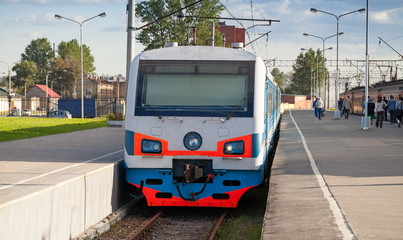 Modern suburban electric train standing at the station in Russia