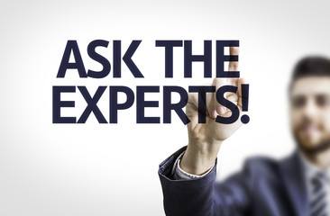 Business man pointing the text: Ask the Experts!