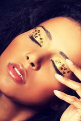 Close up on beautiful tiger make-up.