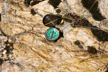 Analogic Compass Abandoned on the Rocks