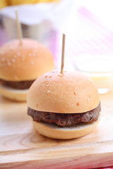 Closeup of Two homemade hamburgers on wooden board