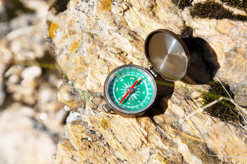 Analogic Compass Abandoned on the Rocks