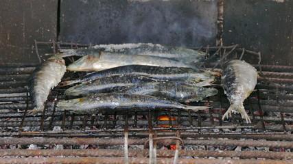 Fish Sardines Grilling on Grid, closeup