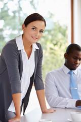 Portrait Of Businesswoman Standing In Boardroom