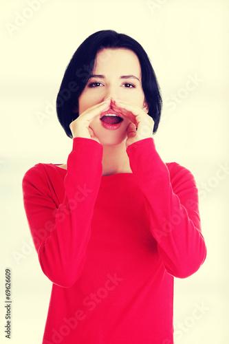 canvas print picture Pretty caucasian woman whispering gossip.
