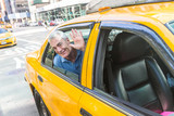 Fototapety Senior Man Taking a Cab in New York
